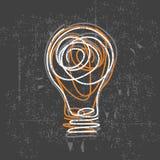 Ampoule d'Uidea sur le panneau noir Images libres de droits