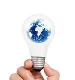 Ampoule dans une main Photos stock