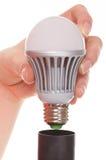 Ampoule de vis dans un capuchon Photographie stock