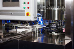 Ampoule filling and sealing machine Stock Photo