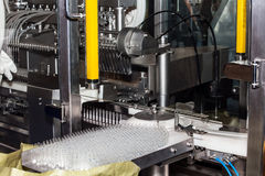 Ampoule filling and sealing machine Stock Images
