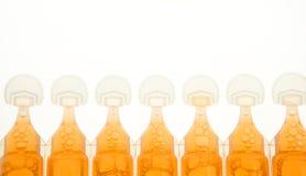Ampoule im plastic for liquid orange medicine Stock Images