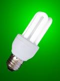 Ampoule inférieure de consommation - d'isolement avec le tapotement de découpage Photos stock
