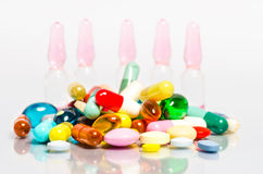Ampoule and pills Royalty Free Stock Photos