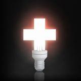 Ampoule rougeoyante dans l'obscurité image stock