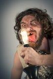 Ampoule stupide d'homme des cavernes Photos stock