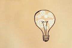 Ampoule sur le fond de papier Photographie stock libre de droits