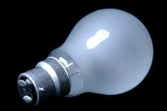 Ampoule sur le fond noir Image stock