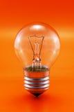 Ampoule sur le rouge Image stock