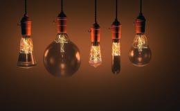 Ampoules de style antique décoratif d'edison sur le fond de mur Photos libres de droits