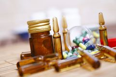 Ampoules and pills for disease Royalty Free Stock Photos