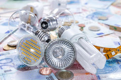 Ampoules sur des billets de banque Photos libres de droits