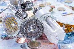 Ampoules sur des billets de banque Photographie stock