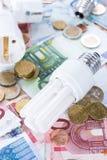Ampoules sur des billets de banque Image stock