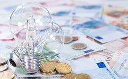 Ampoules sur des billets de banque Photo libre de droits