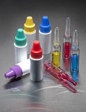 Ampules and bottles Stock Images