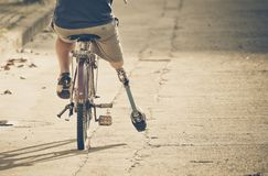 Free Amputee On A Bicycle Royalty Free Stock Photos - 107473408