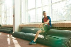 Amputee Sportsman Resting by Window stock image