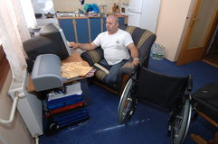 Amputee Working. May 17, 2007 - Though he lost both of his legs to a land mine during Bosnia's brutal civil war, this man received a loan through an Royalty Free Stock Photography