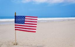 Amrican flag. Patriotic USA background with Amrican flag on the sandy beach Royalty Free Stock Images