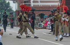 The changing of the guard at the border between India and Pakistan. Amritsar, India - changing of the guard is one of the main attractions for tourists visiting stock photography