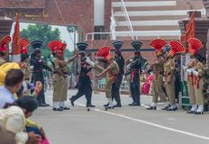 The changing of the guard at the border between India and Pakistan. Amritsar, India - changing of the guard is one of the main attractions for tourists visiting stock photo