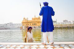 Unidentified Guard standing and looking around near Sri Harmandir Sahib or Golden Temple pond, i stock photography