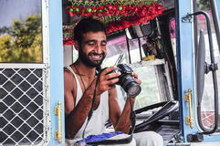 Amritsar, India, september 5, 2010: Indian truck driver watching. A picture on a camera Royalty Free Stock Image