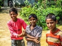 Amroha, Uttar Pradesh, INDIA - 2011: Indian children of slams smilimg Royalty Free Stock Photo