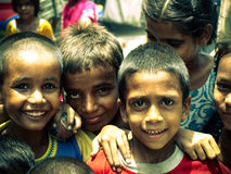 Amroha, Utter Pradesh, INDIA - 2011: Unidentified poor people living in slum. Smiling children Stock Image