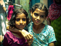 Amroha, Utter Pradesh, INDIA - 2011: Unidentified poor people living in slum. Smiling children Stock Photos