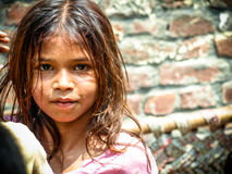 Amroha, Utter Pradesh, INDIA - 2011: Unidentified poor people living in slum. Smiling children Stock Images