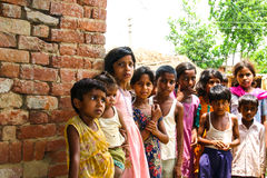 Amroha, Utter Pradesh, INDIA - 2011: Unidentified poor people living in slum. Smiling children Royalty Free Stock Images