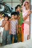 Amroha, Utter Pradesh, INDIA - 2011: Unidentified poor people living in slum. Smiling children Stock Photography