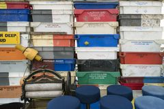 Fishing crates, buoys and other maritime objects in front of the old bar Blaue Maus on the North Frisian island Amrum. AMRUM, GERMANY - JANUARY 02, 2018: Fishing Stock Images