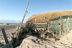 Beach Huts and other Objects out of Flotsam and Jetsam. AMRUM, GERMANY - JANUARY 02, 2018: On the Kniepsand Beach of  the North Frisian Island Amrum in Germany Royalty Free Stock Photography