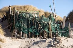 Beach Huts and other Objects out of Flotsam and Jetsam. AMRUM, GERMANY - JANUARY 02, 2018: On the Kniepsand Beach of  the North Frisian Island Amrum in Germany Stock Photography