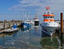Amrum, Germany - May 27th, 2016 - Harbor on the island of Amrum with fishing boats and life boat Stock Images