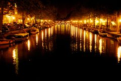 Amstel Canal with night lights in Amsterdam Royalty Free Stock Photography