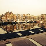 The Amstel canal with old mansions and houseboats in the centre of Amsterdam, the Netherlands stock photo