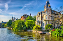 Amstel river with beautiful houses in Amsterdam, Holland, Nether Stock Photos