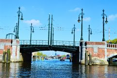 Amstel river, bridge, boats, Netherlands, Europe and colorful buildings stock image