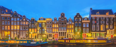 Amstel river, canals and night view of beautiful Amsterdam city. Netherlands.  Royalty Free Stock Photo