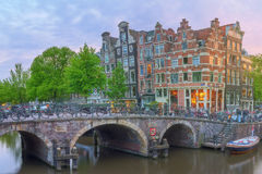 Amstel river, canals and night view of beautiful Amsterdam city. Netherlands Stock Photos