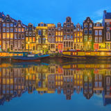 Amstel river, canals and night view of beautiful Amsterdam city. Netherlands Royalty Free Stock Images