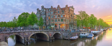 Amstel river, canals and night view of beautiful Amsterdam city. Netherlands.  Stock Photography