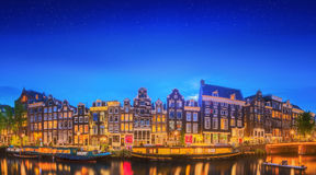 Amstel river, canals and night view of beautiful Amsterdam city. Netherlands Stock Images