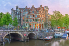 Amstel river, canals and night view of beautiful Amsterdam city. Netherlands Royalty Free Stock Photo