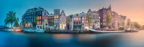 River, canals and traditional old houses Amsterdam. Amstel river, canals and sunrise over beautiful Amsterdam city. Netherlands stock images
