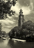 Amstel river and Westerkerk church in Amsterdam. Stock Image